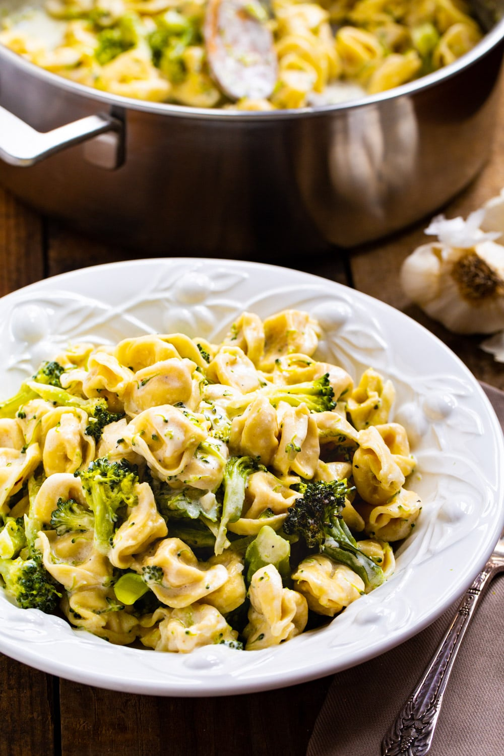Broccoli Alfredo Tortellini dished up in a pasta bowl.