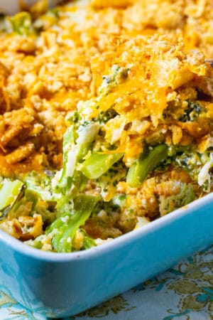 Wooden spoon scooping up Southern Broccoli Casserole.