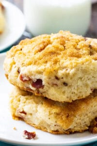 Two Brown Sugar and Bacon Biscuits on a plate.