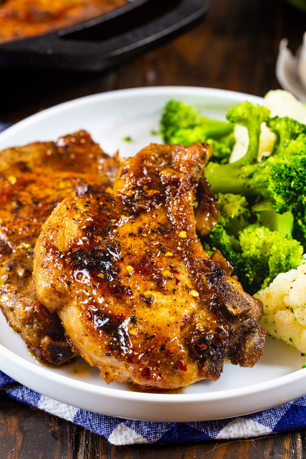 Brown Sugar Garlic Pork Chops on a plate with broccoli.