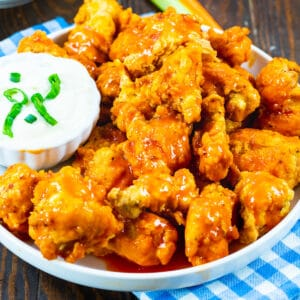 Buffalo Chicken Nuggets on a plate with Blue cheese dipping sauce.