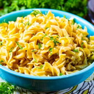 Buttered Noodles in a blue bowl.