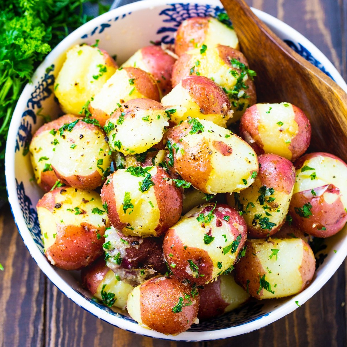 Buttered Parslied Potatoes in a serving bowl.
