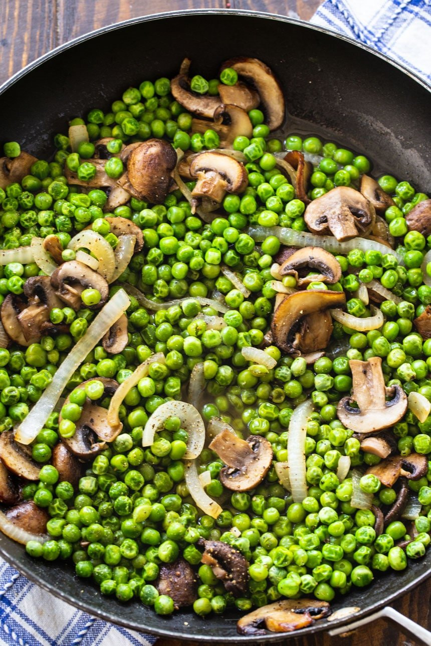 Buttered Peas and Mushrooms in a large skillet