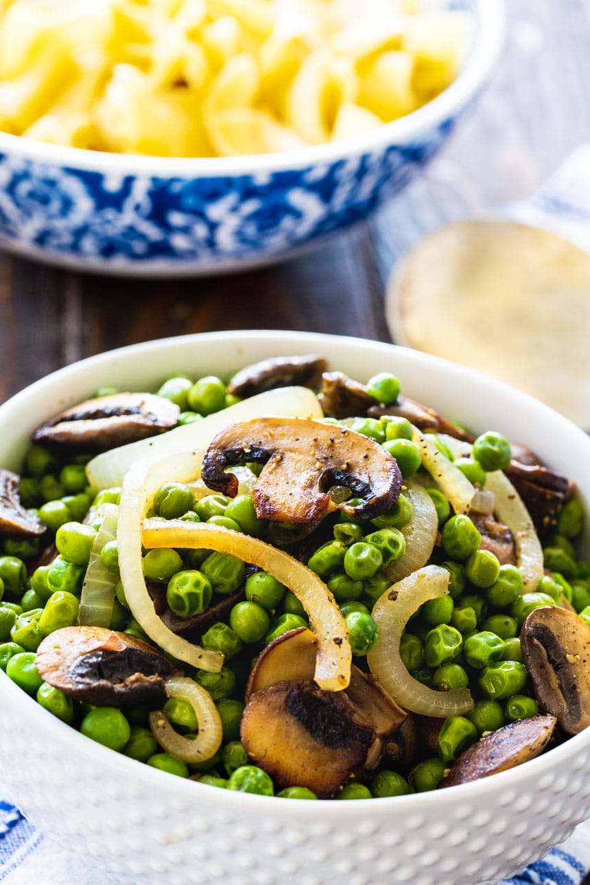 Buttered Peas with Mushrooms in a white bowl.