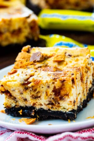 Butterfinger Cheesecake Bars on a plate.