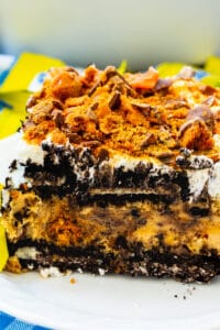Slice of Butterfinger Oreo Icebox Pie on a plate.