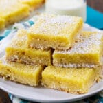 Buttermilk Chess Bars stacked on a plate.