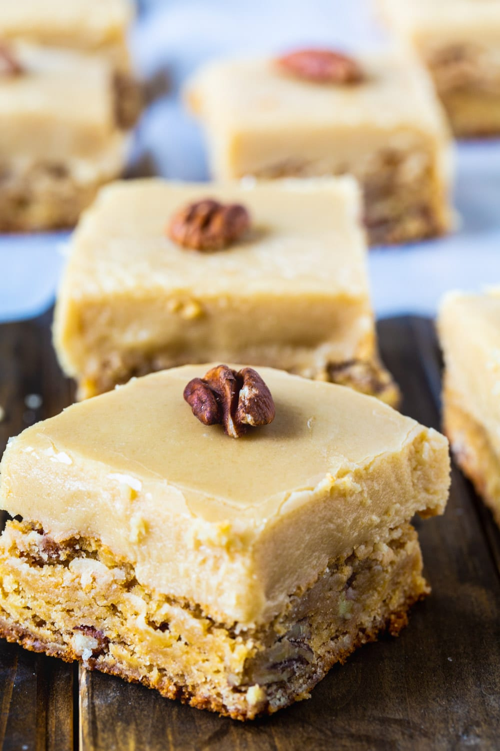 Butterscotch Blondies squares with whole pecans on top.