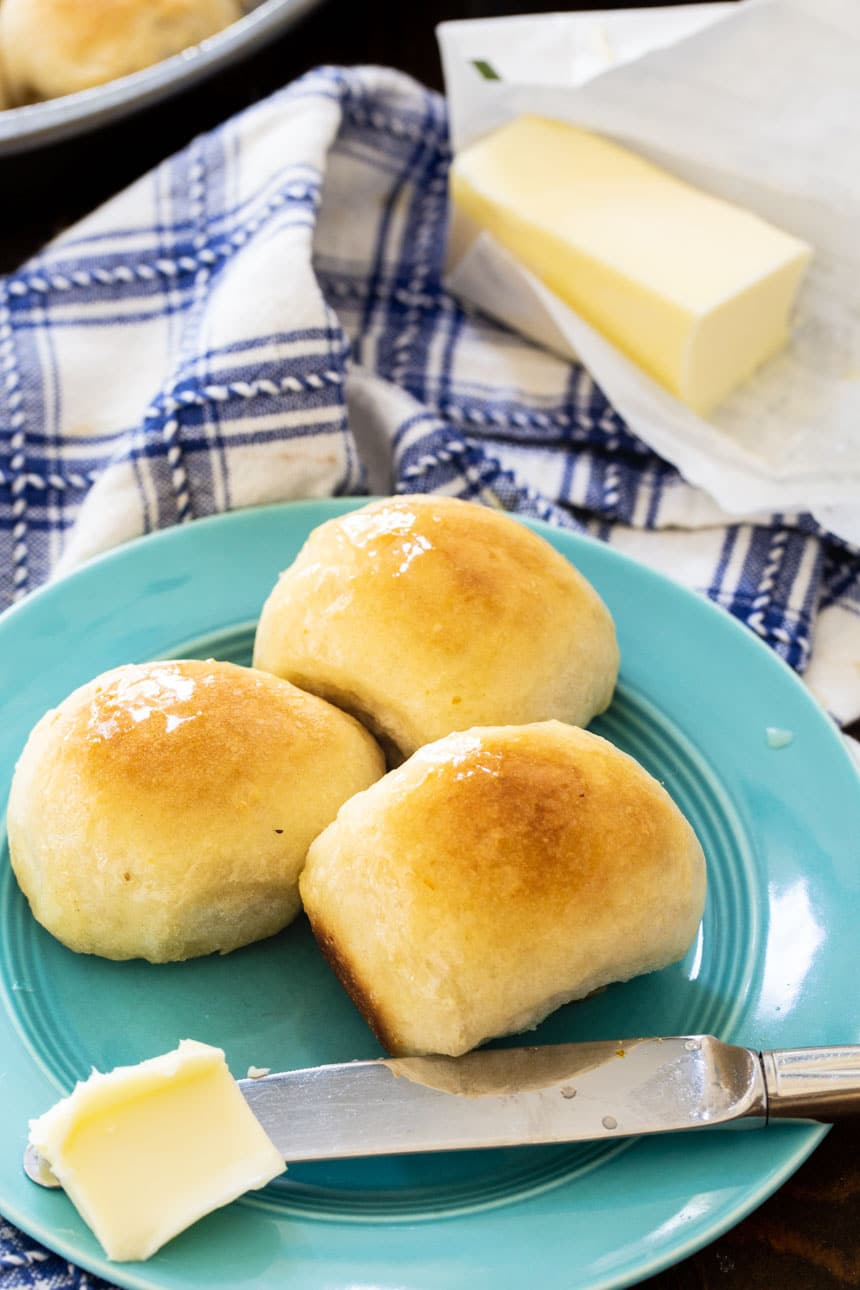 3 Buttery Pan Rolls on a blue plate