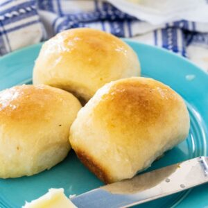 3 Buttery Rolls on a blue plate.