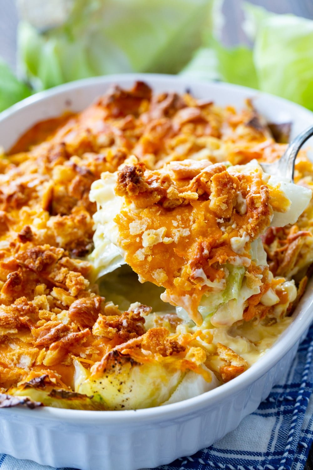 Spoon scooping Old-Fashioned Cabbage Casserole.