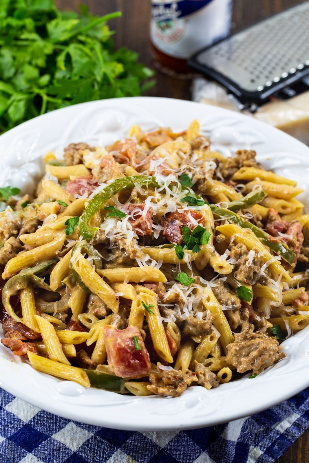 Cajun Pasta in a bowl and a bunch of parsley.