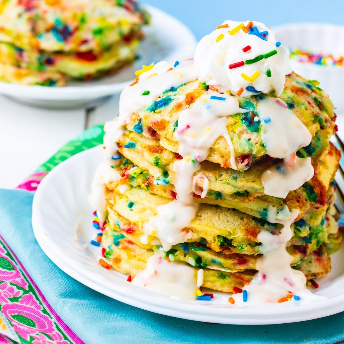 Cake Batter Pancakes stacked on a plate.