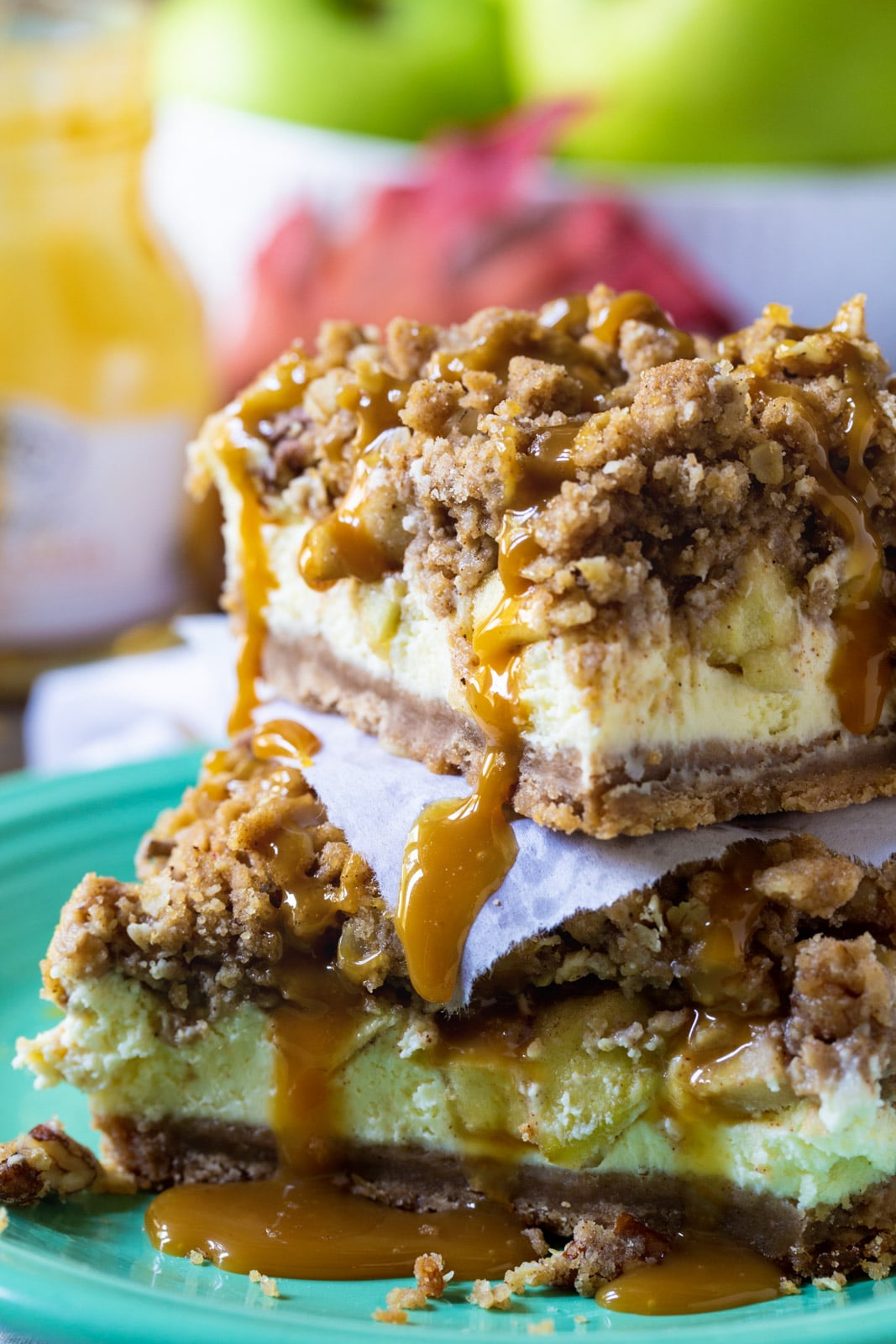 Caramel Apple Cheesecake Bars stacked on top of each other.