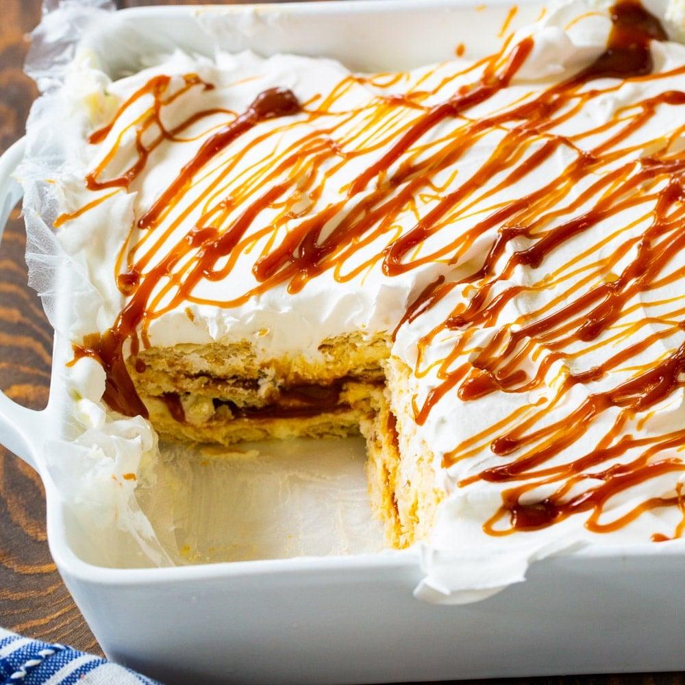 Caramel Ritz Cracker Icebox Dessert with piece cut out.