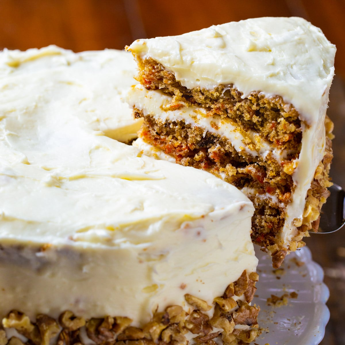 Slice of Mama Dip's CArrot Cake being lifted up.