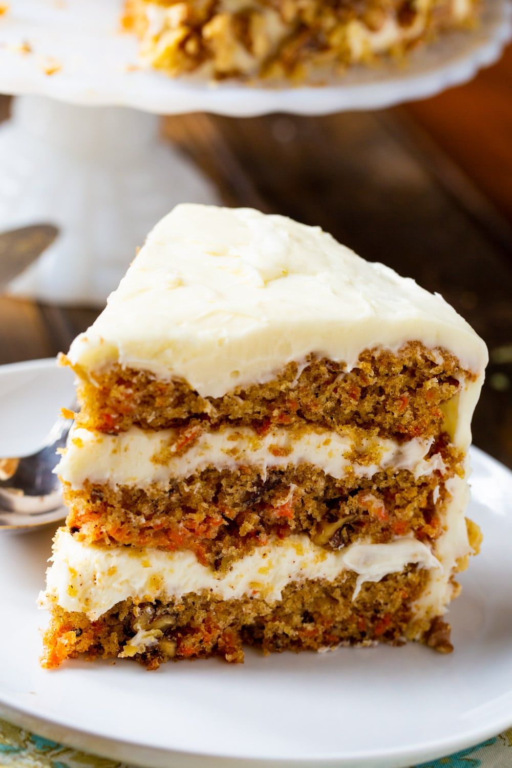 Slice of Mama Dip's Carrot Cake on a plate.