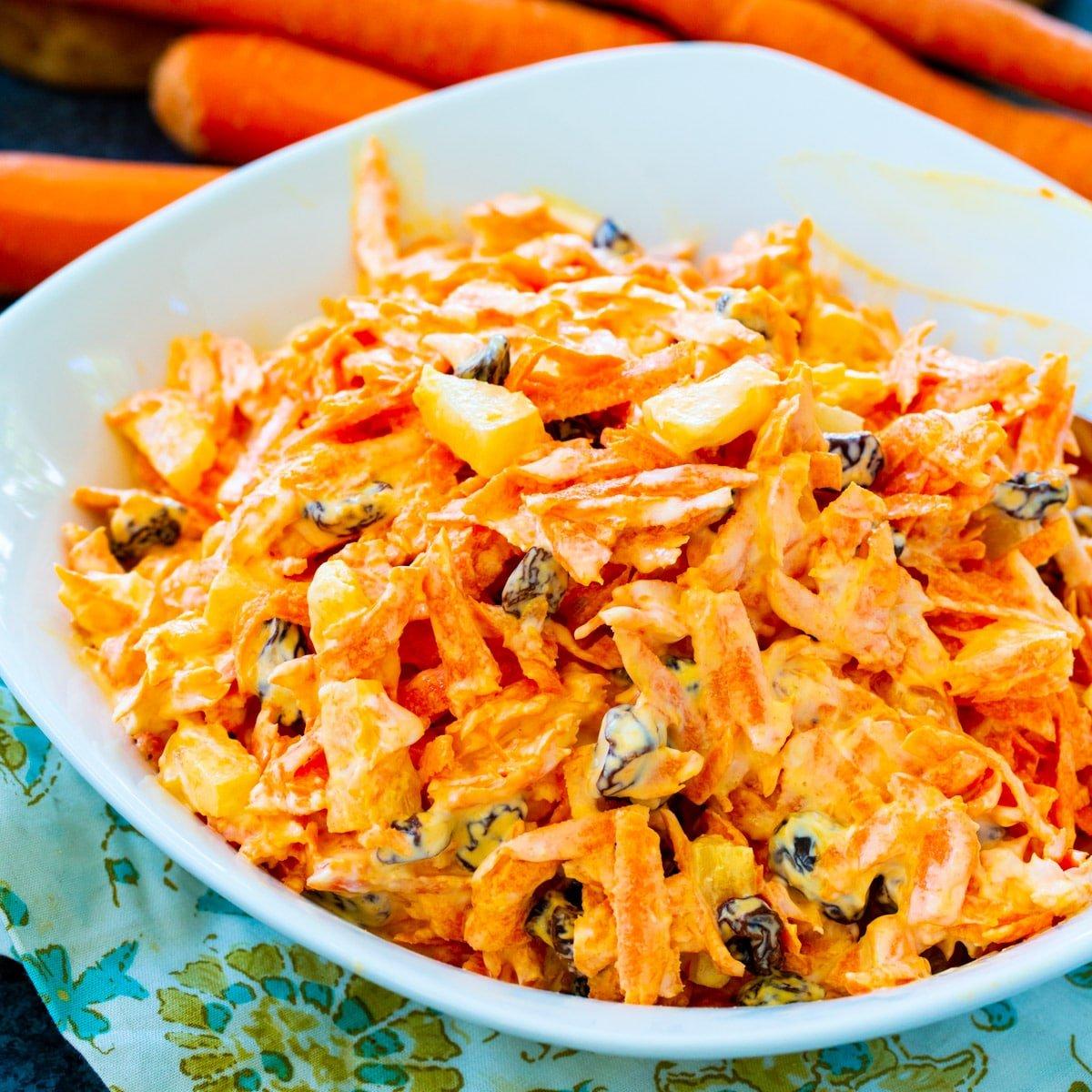 Carrot Raisin Salad in a white bowl.