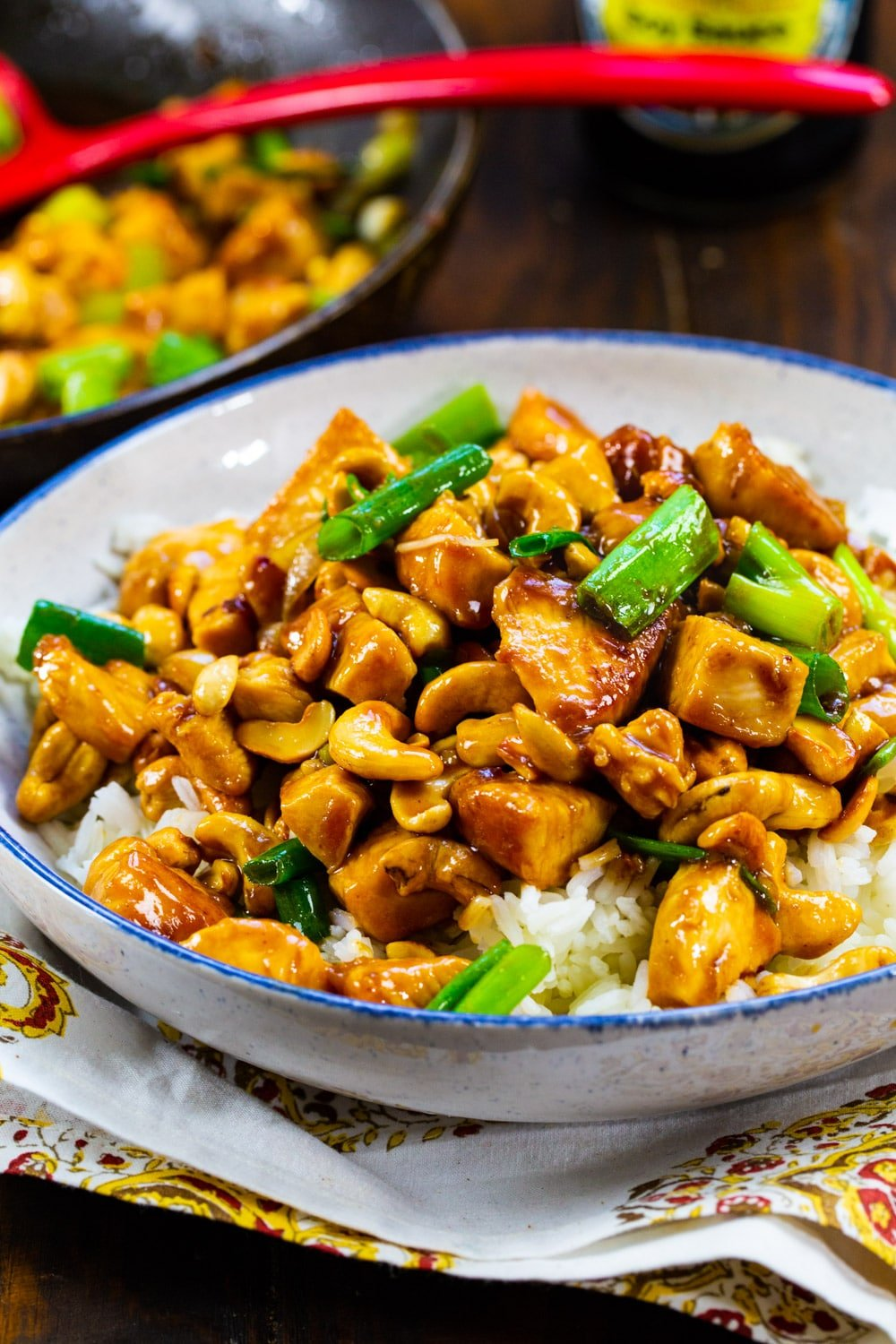 Cashew Chicken over white rice in a bowl.