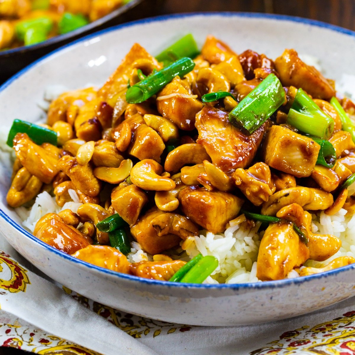 Cashew Chicken over rice in a bowl.