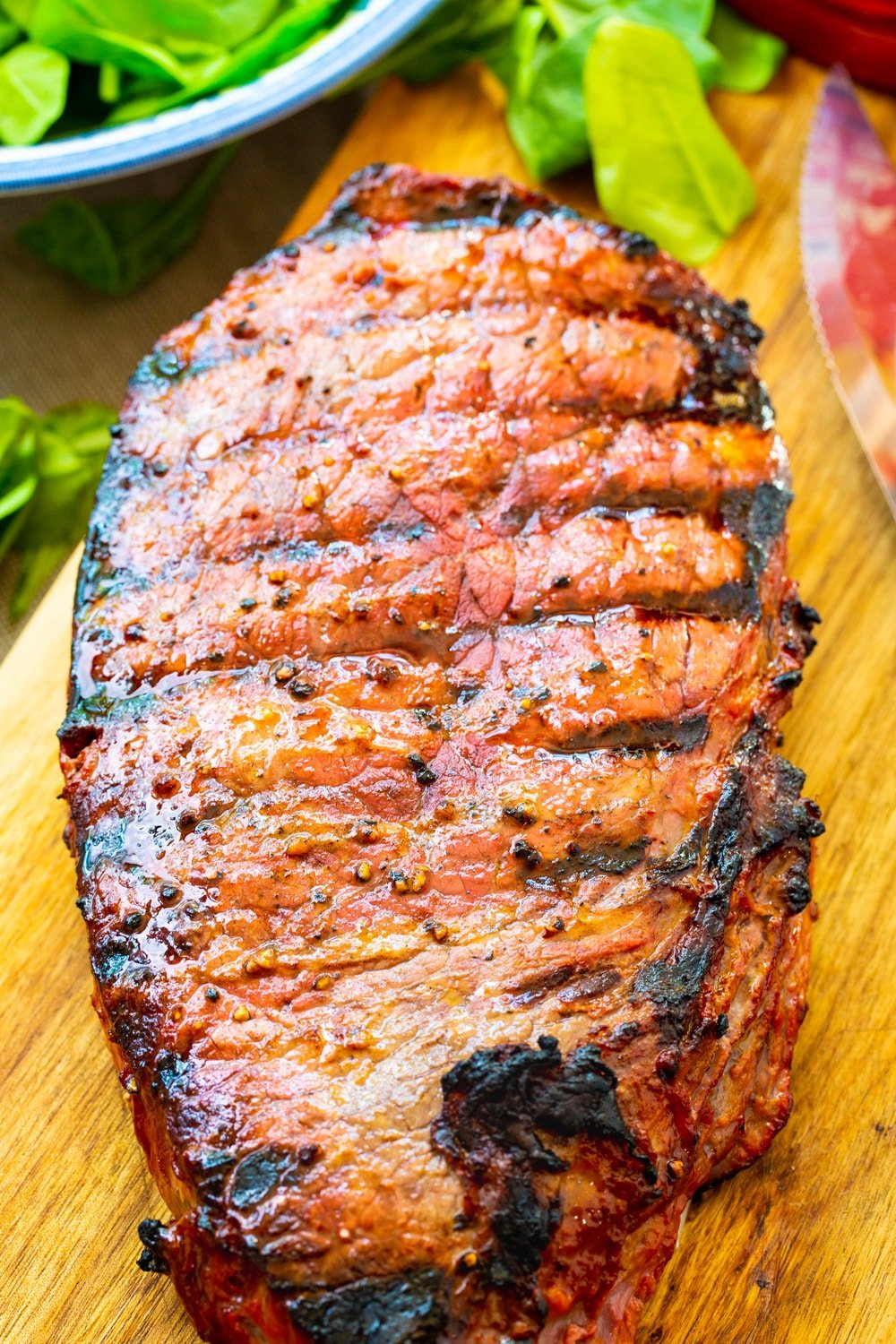 Grilled London Broil on a cutting board.