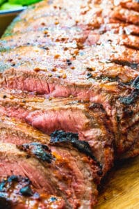 Catalina London Broil on a wood cutting board with slices cut.