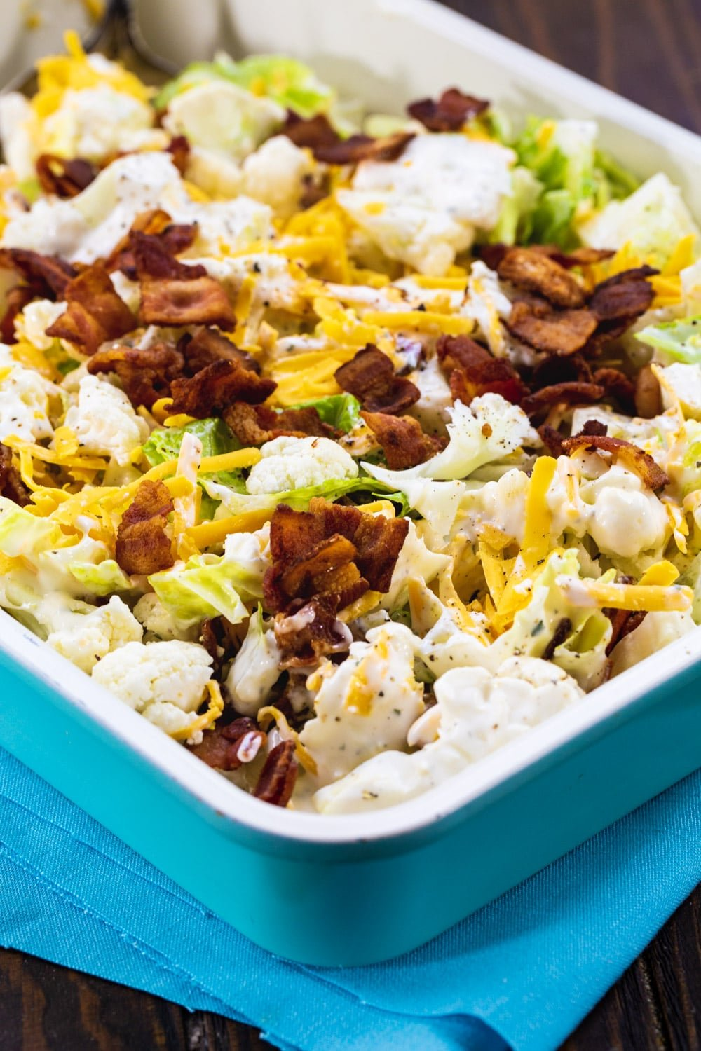 Bacon and Ranch Cauliflower Salad in blue 9x13-inch pan.