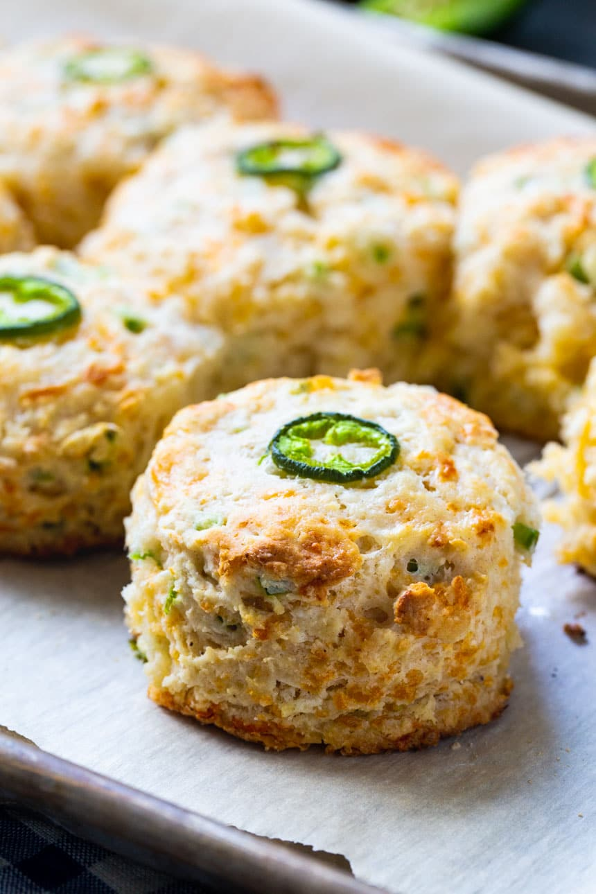 Jalapeno Cheddar Biscuits topped with jalapeno slice.