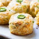 Jalapeno Cheddar Biscuits on parchment paper.