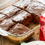 Cheerwine Chocolate Cake cut into squares in a baking dish.