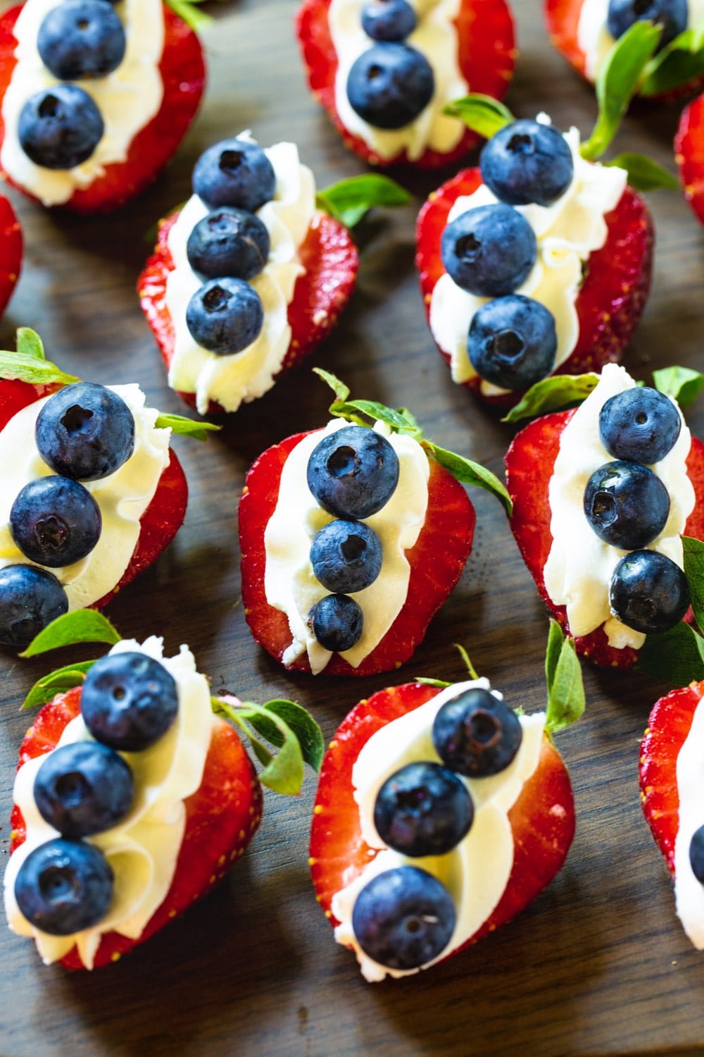 Cheesecake Stuffed Strawberries topped with blueberries.