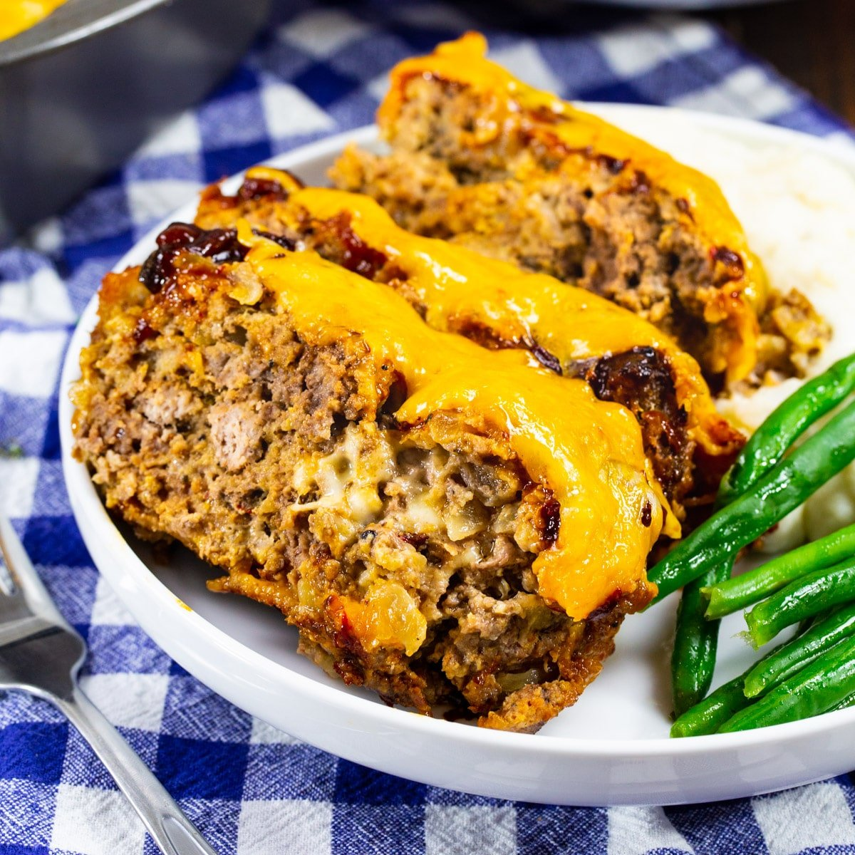 Three slices of Cheesy Chipotle Meatloaf on a plate.