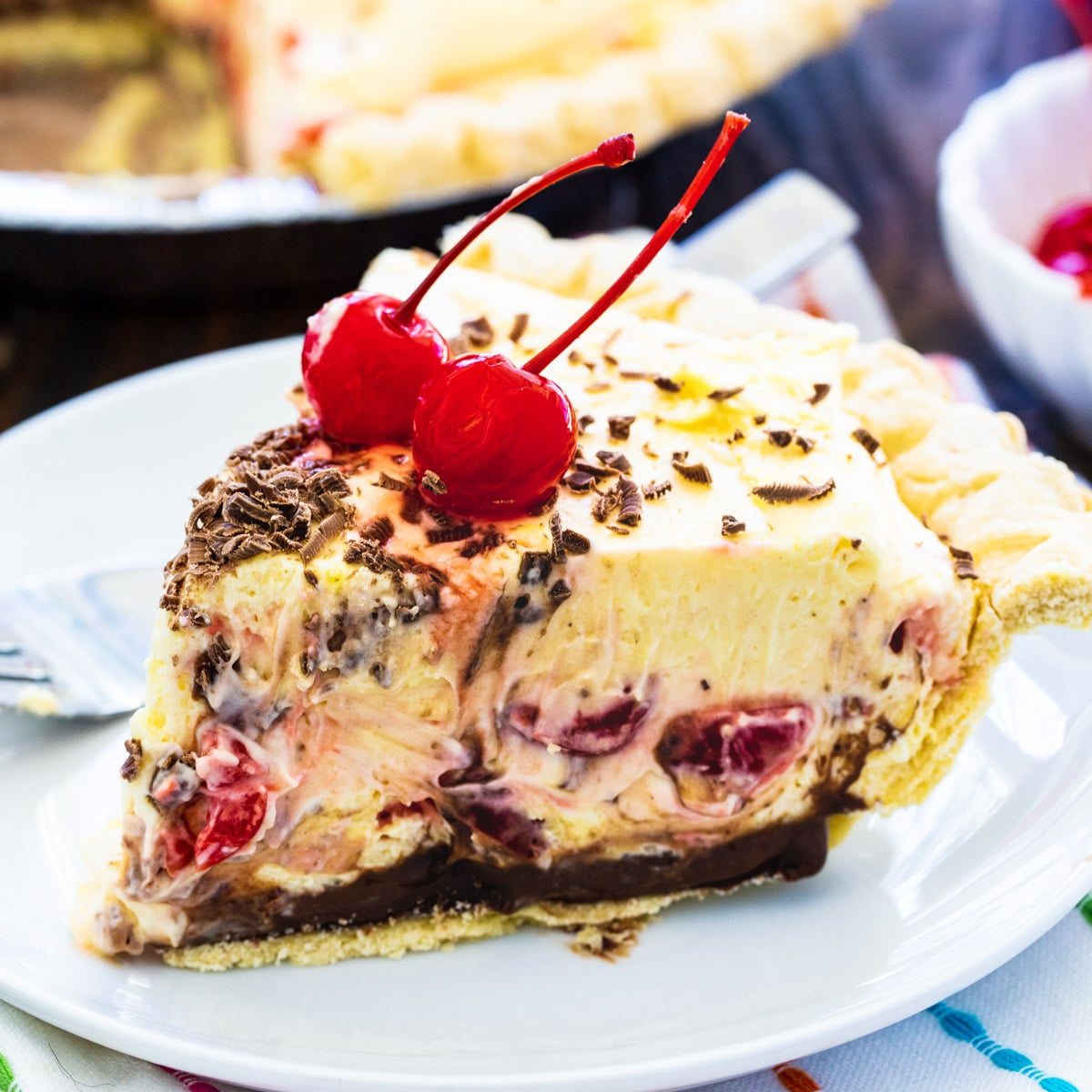 Slice of Cherry Almond Mousse Pie on a plate.
