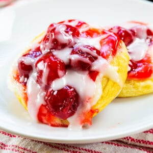 Two Cherry Danishes on a plate.