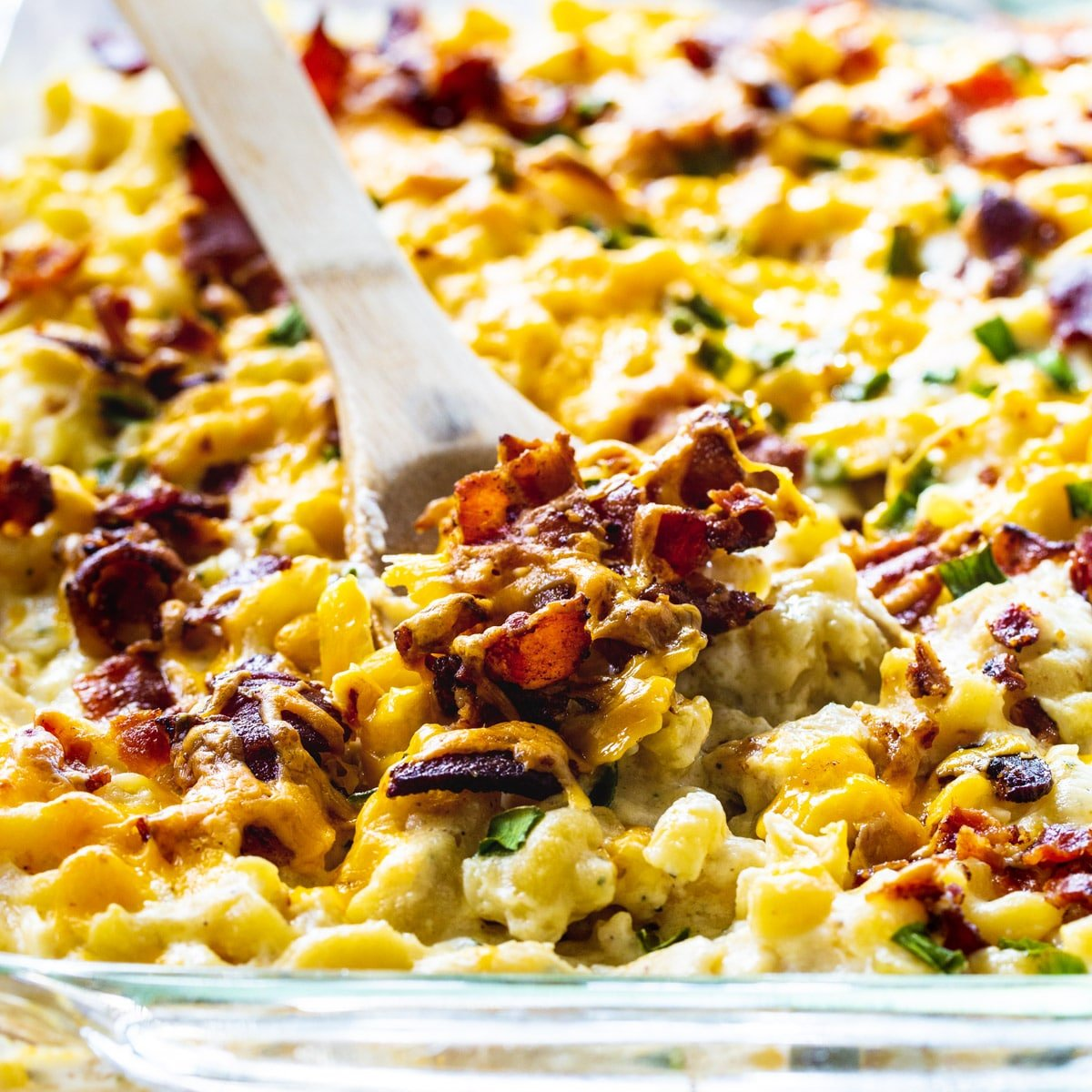Wooden spoon scooping Chicken, Bacon, and Ranch Mac and Cheese.