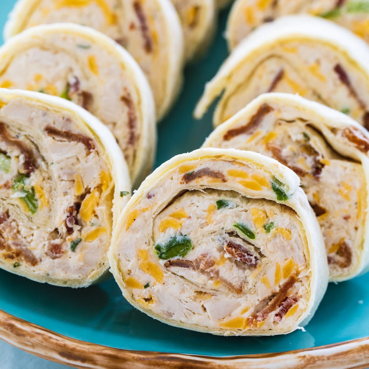Chicken, Bacon, and Ranch Pinwheels on blue serving plate.