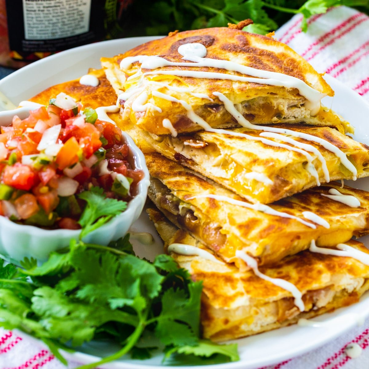 Chicken, Bacon and Ranch Quesadillas cut into triangles and stacked.