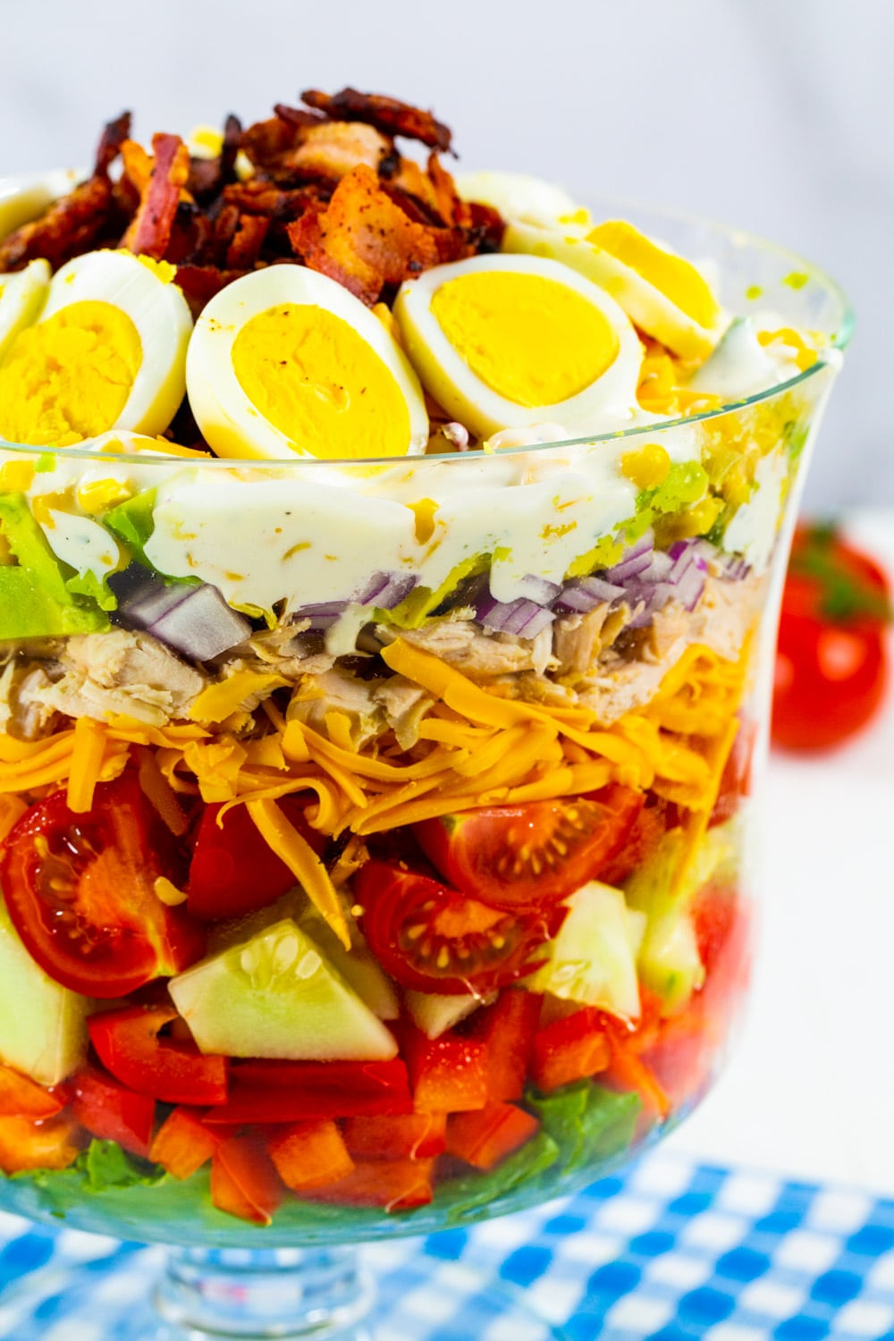 Chicken Bacon Ranch Layer Salad in a glass trifle bowl.