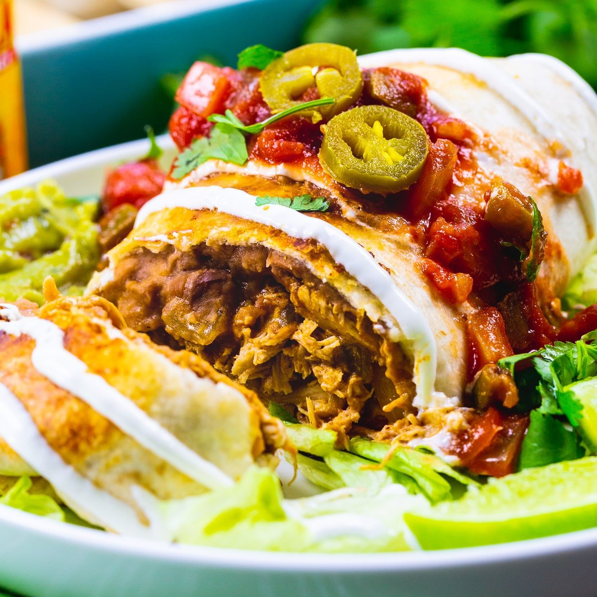 Baked Chicken Chimichanga cut open to show inside.