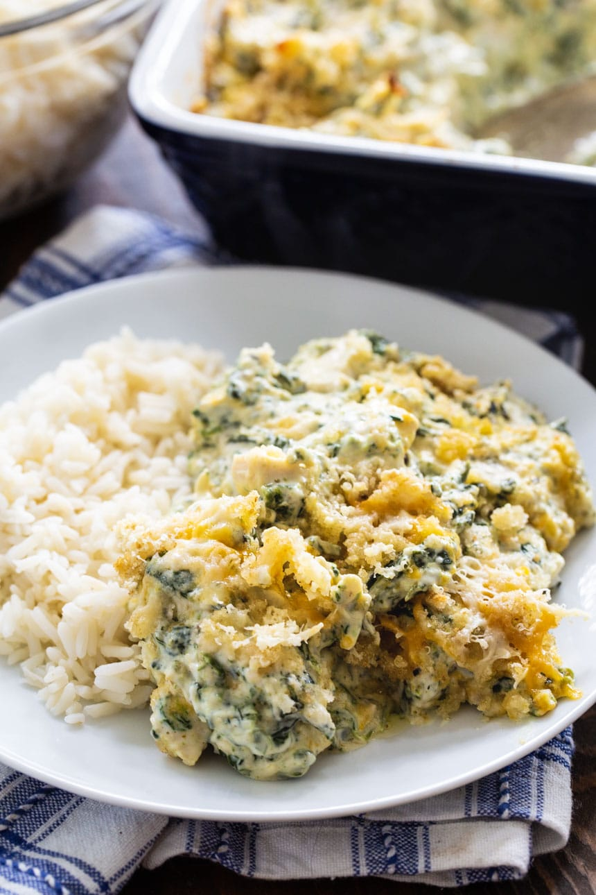 Serving of chicken casserole with spinach on a plate.