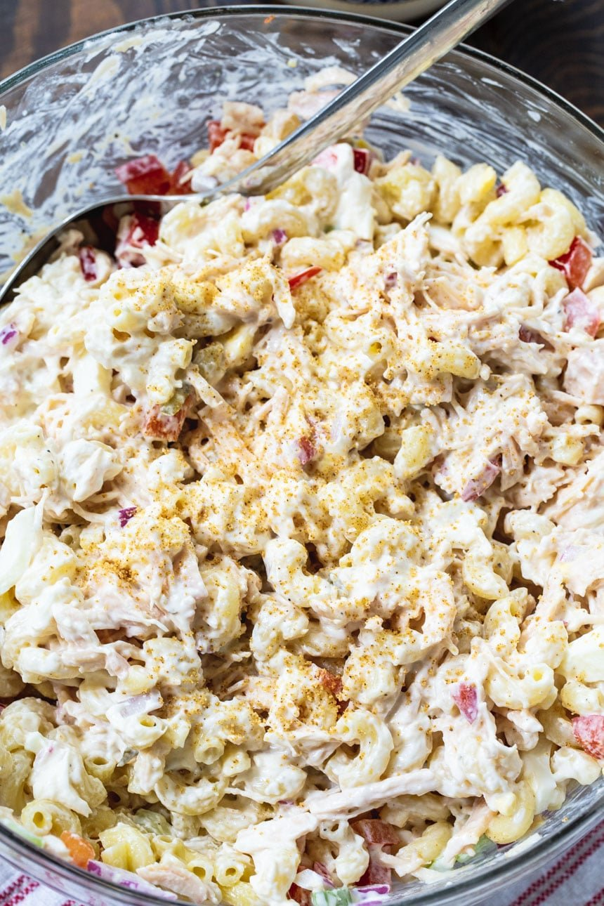 Chicken Macaroni Salad close-up in a glass serving bowl.
