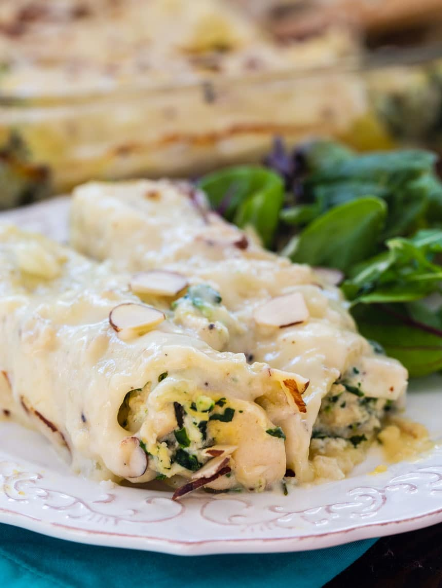 Creamy Chicken Manicotti on a plate with green salad