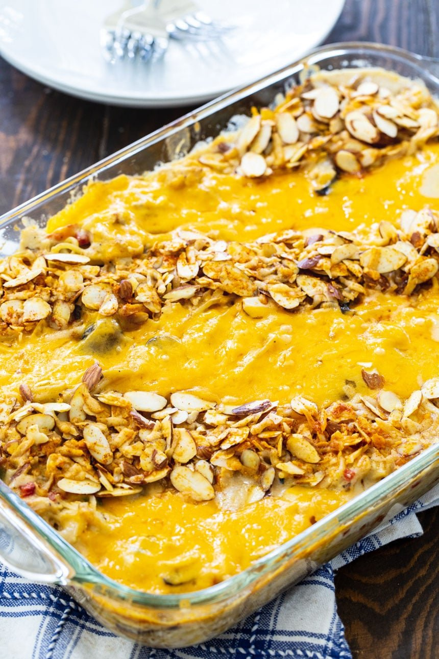Chicken Tetrazzini topped with almonds and cheese in a 9x13-inch baking dish.