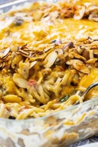 Tetrazzini in a baking dish with a serving spoon.
