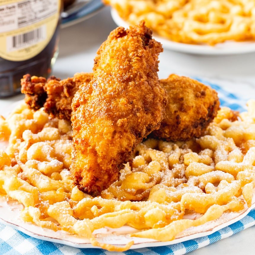 Fried chicken served on a funnel cake