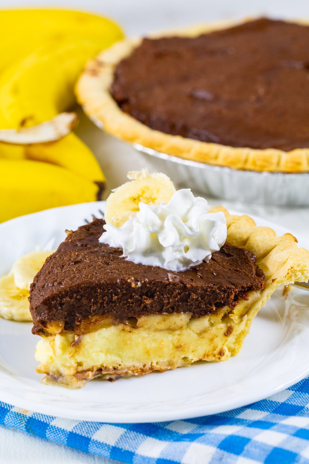 Slice of Banana Cream Pie with Chocolate on a plate.