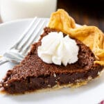 Slice of Chocolate Chess Pie on a plate.