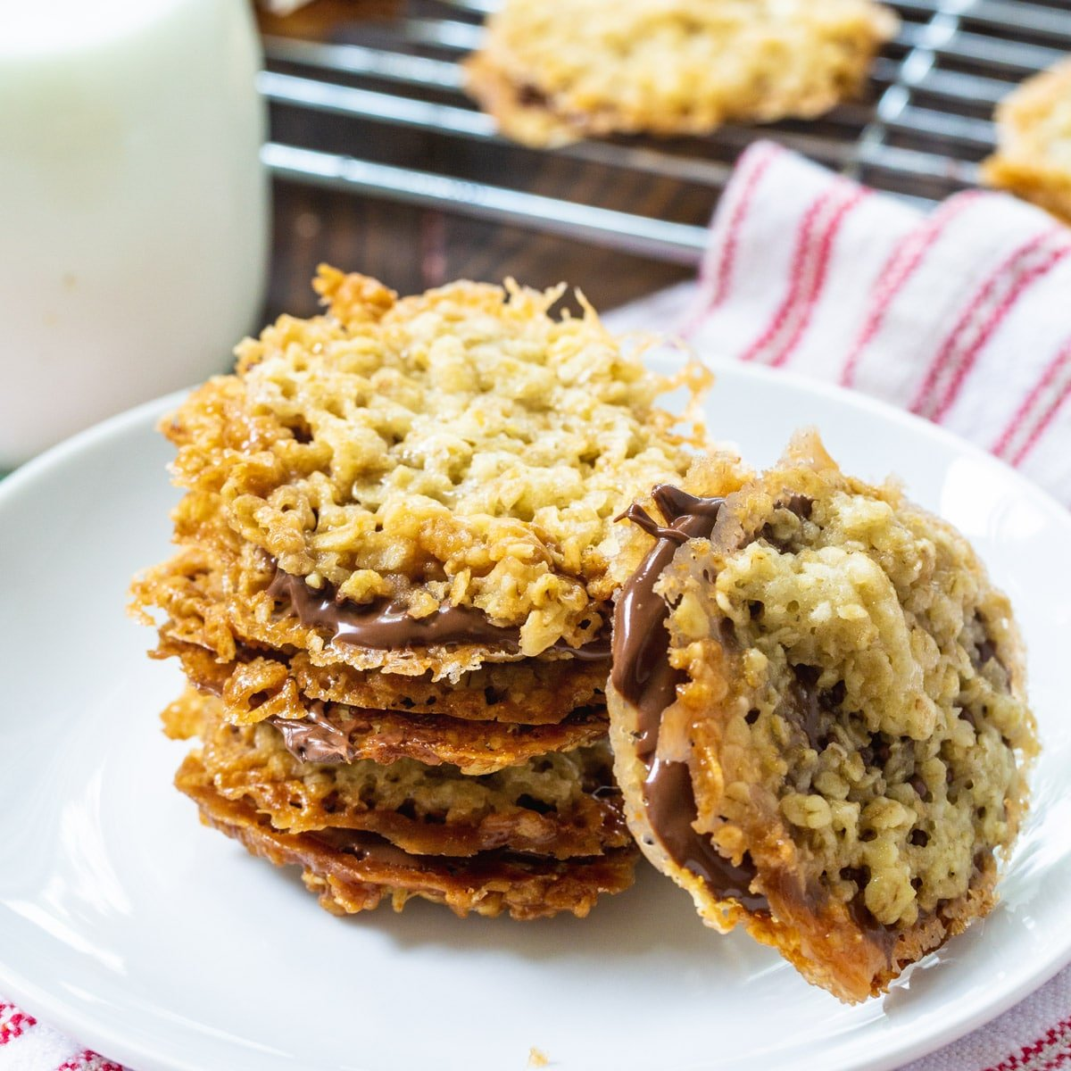 Chocolate Florentine Cookies stacked on a plate.