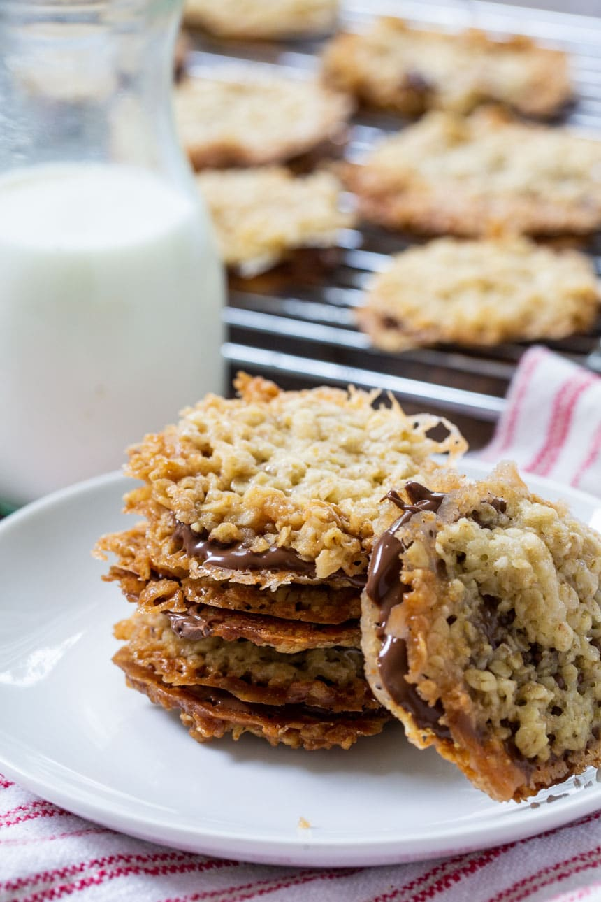 Chocolate Florentine Cookies on plate with jug of milk.